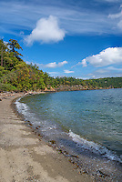WASJ_D226 - USA, Washington, San Juan Islands, Orcas Island, Obstruction Pass State Park, Curved gravel beach, rocky shoreline and forest of Pacific madrone and Douglas fir.