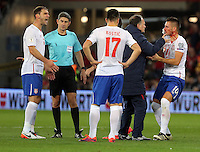 Dusan Tadic of Serbia (R) receives first aid by team physiotherapists after being injured on the face during the 2018 FIFA World Cup Qualifier between Wales and Serbia at the Cardiff City Stadium, Wales, UK. Saturday 12 November 2016