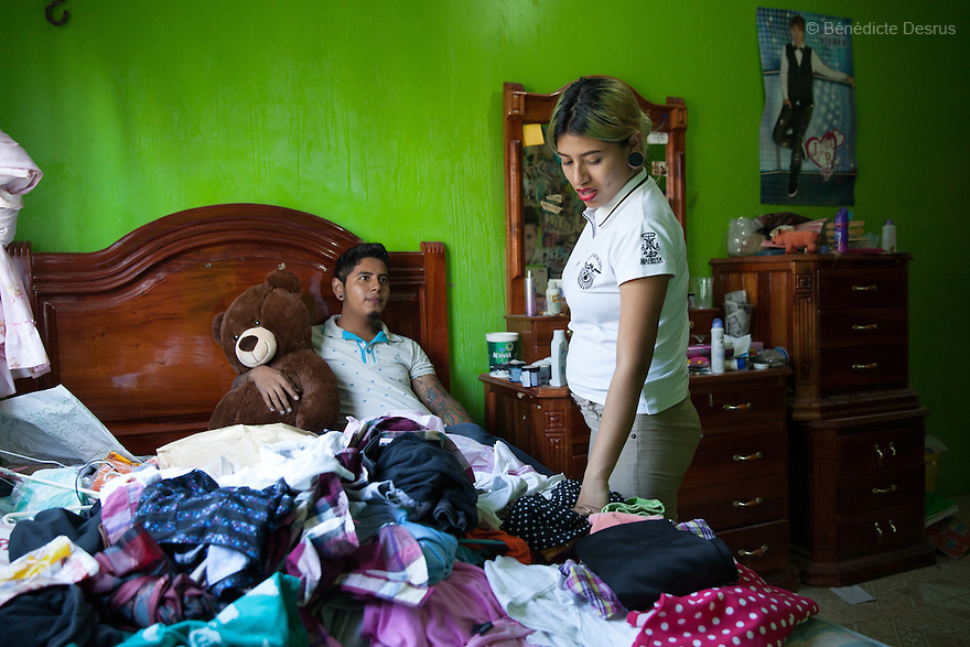 Xochiquetzal S&aacute;nchez Escobar with her boyfriend Rub&eacute;n in her bedroom at her home in Juchit&aacute;n, Mexico on February 18, 2016. Despite her teenage rebel style, Xochi, as she is known, dressed in the traditional Zapotec style for her engagement party. She is 17 and five months pregnant. The daughter of a single-mother former missionary and nun, Xochi says she had always talked about having a baby in her teens because she thought her mother was old when she had her at 28. She kept her pregnancy secret from her mother until February. After the baby - a boy, David Mateo - is born in June, she plans to move with her boyfriend to a house where they will live together and he will have his tattoo studio, and they plan to marry next June. She plans to finish her final year of secondary school in the town of El Espinal in the southern Mexican state of Oaxaca next year, with her mother looking after the baby in the mornings while she is in class. Being a schoolgirl housewife does not worry her, she says, although she admits she cannot cook. Her grandmother, who lives with the family, is thrilled at the prospect of a great-grandchild. Xochi dreams of giving birth in water, but is not sure that will happen. While Mexico has outlawed marriage under the age of 18, many young girls become unofficial wives and mothers much earlier. In Juchit&aacute;n, teenage pregnancy is expected, even prized. Mexico ranks first in teenage pregnancies among the member countries of the Organization for Economic Co-operation and Development&nbsp;(OECD). Photo by B&eacute;n&eacute;dicte Desrus<br /> &nbsp;