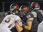 Lawndale, CA 11/11/16 - Angel Becerra (Lawndale #56), Damian Gutierrez (Lawndale #63) and Matthew Driesler (West Torrance #65) in action during the West Torrance - Lawndale CIF first round playoffs.  Lawndale defeated West Torrance 48-14.