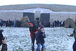 Newgrange Co Meath, 21th December winter solstice, No sun rise this year but a blanket of snow decended on the Tomb in Co Meath. Leah Geough and Eolain Downey playin gin the snow at Newgrange..Picture Fran Caffrey /www.newsfile.ie.