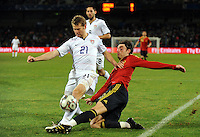 Albert Riera of Spain is tackled by Jonathan Spector of USA. USA defeated Spain 2-0 during the semi-finals of the FIFA Confederations Cup at Free State Stadium in Manguang/Bloemfontein, South Africa on June 24, 2009..