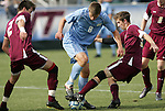 13 November 2011: North Carolina's Martin Murphy (8) is defended by Boston College's Chris Ager (NOR) (2) and Ryan Dunn (right). The University of North Carolina Tar Heels defeated the Boston College Eagles 3-1 at WakeMed Stadium in Cary, North Carolina in the Atlantic Coast Conference Men's Soccer Tournament championship game.