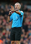 Referee Martin Atkinson pauses the match to wait for a VAR decision during the Premier League match at the Emirates Stadium, London. Picture date: 7th March 2020. Picture credit should read: Paul Terry/Sportimage