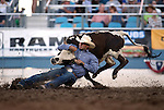 Tyler Mitchell competes in the steer wrestling event at the Reno Rodeo in Reno, Nev., on Thursday, June 27, 2013.<br /> Photo by Cathleen Allison