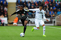 Leandro Bacuna of Reading vies for possession with Martin Olsson of Swansea City during the Sky Bet Championship match between Swansea City and Reading at the Liberty Stadium in Swansea, Wales, UK. 27th October, 2018