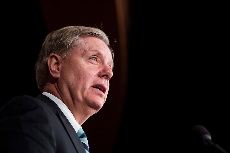 UNITED STATES - OCTOBER 30: Sen. Lindsey Graham, R-S.C., speaks in the Senate Radio/TV Gallery studio during the news conference on Benghazi on Wednesday, Oct. 30. 2013. (Photo By Bill Clark/CQ Roll Call)