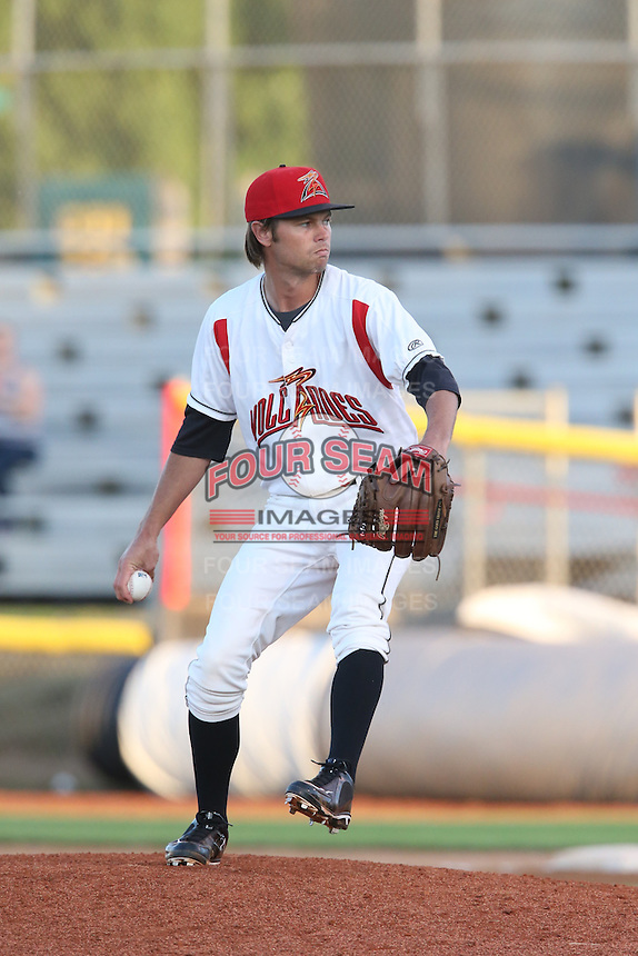 Kirk Singer #13 of the Salem-Keizer Volcanoes pitches against the Spokane Indians at Volcanoes Stadium on July 26, 2014 in Keizer, Oregon. Spokane defeated Salem Keizer, 4-1. (Larry Goren/Four Seam Images)
