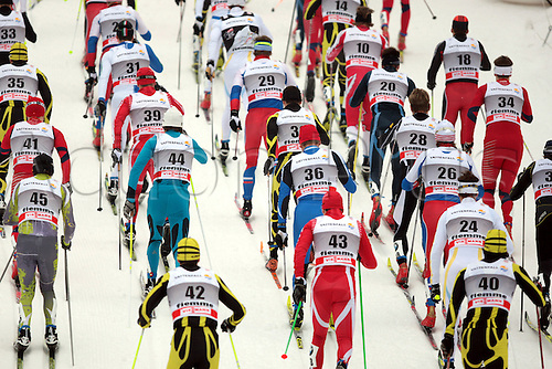 08.01.2011.  TOUR DE SKI - STAGE 7. Skiers at the start of the 20 km classic mass start in Val Di Fiemme, Italy.