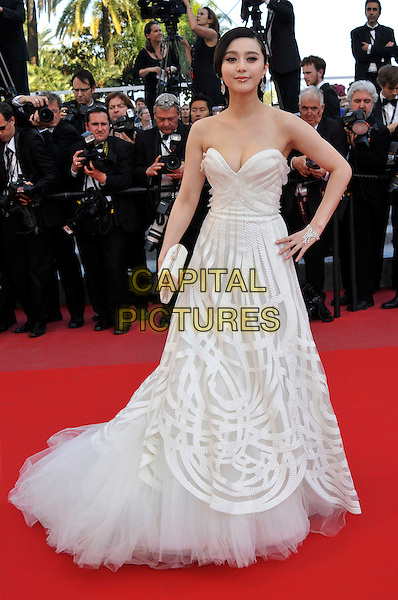 FAN BINGBING.(BING BING, BING-BING).'Biutiful' premiere at the 63rd International Cannes Film Festival, Cannes, France, May 17th 2010..full length  strapless white dress long maxi tulle clutch bag patterned pattern hand on hip ballgown gown .CAP/PL.©Phil Loftus/Capital Pictures.