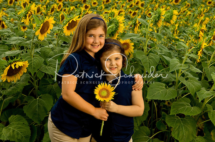 On-location photography of Charlotte's annual Field of Dreams event, during which Charlotte-area professional photographers donate their time creating images of cancer survivors. The sunflower field is located on farm land in Weddington, NC. Photographer Julie Staley of In His Image photography coordinates the event.