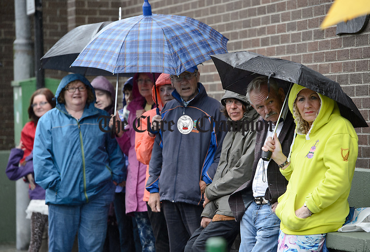 Despite the weather, the audience enjoys The  Dying Kicks who were playing at Barrack street during Fleadh Cheoil na hEireann in Ennis. Photograph by John Kelly.