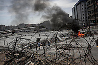 In this Tusday, Jun. 11, 2013 photo, a truck set up in fire burns at one barricade during clashes between protesters and the anti-riot police at the streets of Taksim Square in Istanbul,Turkey. (Photo/Narciso Contreras).