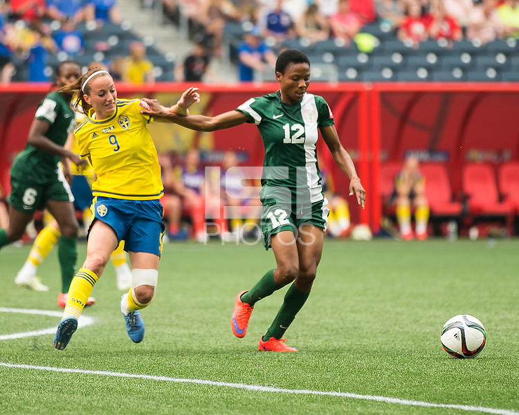 WINNIPEG, MANITOBA, CANADA - June 8, 2015: The Woman's World Cup Sweden vs Nigeria match at the Winnipeg Stadium . Final score, Sweden 3, Nigeria 3.