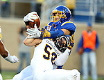 BROOKINGS, SD - SEPTEMBER 24:  Dallas Goedert #86 from South Dakota State University wrestles his way over Riggs Baxter #58 from Western Illinois for a touchdown in the first half of their game Saturday evening at Dana J. Dykhouse Stadium in Brookings. (Photo by Dave Eggen/Inertia)