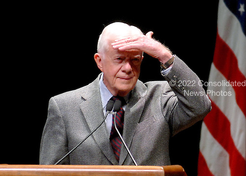 """Washington, D.C. - March 8, 2007 -- Former United States President Jimmy Carter shields his eyes from the bright lights while listening to a student's question concerning his controversial book  """"Palestine: Peace Not Apartheid"""" during an appearance at George Washington University in Washington, D.C. on Thursday, March 8, 2007.<br /> Credit: Ron Sachs / CNP"""