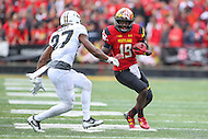 College Park, MD - October 1, 2016: Maryland Terrapins wide receiver Teldrick Morgan (19) tries to avoid Purdue Boilermakers safety Navon Mosley (27) during game between Purdue and Maryland at  Capital One Field at Maryland Stadium in College Park, MD.  (Photo by Elliott Brown/Media Images International)