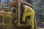 August 21, 2001 Coulterville, California  -- Creek Fire – CDF bulldozer operators make plans before cutting fire breaks on Cuneo Road.  The Creek Fire burned 11,500 acres between Highway 49 and Priest-Coulterville Road a few miles north of Coulterville, California.