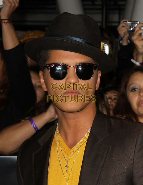"Bruno Mars.""The Twilight Saga: Breaking Dawn Part 1"" Los Angeles Premiere Held At The Nokia Theatre L.A. Live, Los Angeles, California, USA, 14th November 2011..portrait headshot ray bans  cross necklace  brown suit yellow t-shirt hat sunglasses jacket .CAP/ADM/KB.©Kevan Brooks/AdMedia/Capital Pictures."