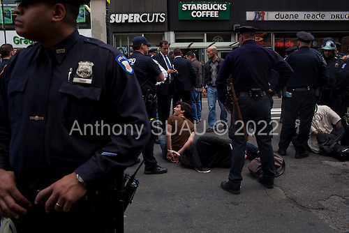 New York, New York<br /> May 1, 2012<br /> <br /> May Day in Manhattan as demonstrators come out in strength to mark the day and support the &quot;Occupy&quot; movement.<br /> <br /> Anarchists moving from Washington Square Park towards Union Square scuffle with police and several are arrested. One demonstrator lays in the streets cuffed and injured bleeding from a head wound.