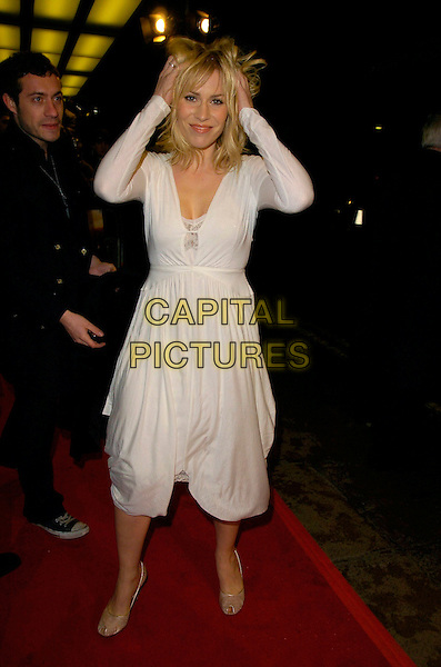 "NATASHA BEDINGFIELD.At the UK Premiere of ""Amazing Grace"",.Curzon Mayfair Cinema, London, England,.March 19th 2007..full length beddingfield white dress funny hands on head hair.©Can Nguyen/Capital Pictures"
