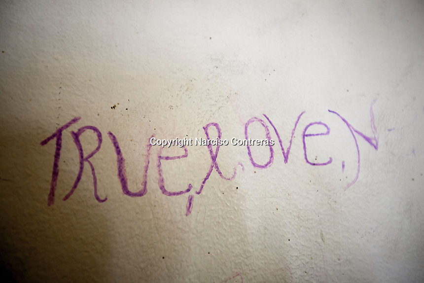 November 20, 2014 - Misrata City, Libya: A graffiti is seen at a wall inside a migrants detention center at the outskirts of Misrata. Libya's revenues from smuggling trade including human trafficking is up to 10% of the national GDP, making this one of the most profitable illegal business across the country. In spite of the international concern of human rights violations, Sub-Saharan migrants risk their lives across Libya, often jailed, sold and kidnapped during their hazardous trip through the Sahara desert to the coastal ports as most of them attempt to reach Europe. (Photo/Narciso Contreras)
