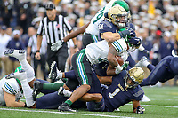 Annapolis, MD - October 26, 2019: Navy Midshipmen linebacker Diego Fagot (54) tackles Tulane Green Wave running back Amare Jones (11) during the game between Tulane and Navy at  Navy-Marine Corps Memorial Stadium in Annapolis, MD.   (Photo by Elliott Brown/Media Images International)