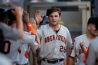 Aberdeen Ironbirds Andrew Daschbach (28) high fives teammates during a NY-Penn League game against the Staten Island Yankees on August 22, 2019 at Richmond County Bank Ballpark in Staten Island, New York.  Aberdeen defeated Staten Island 4-1 in a rain shortened game.  (Mike Janes/Four Seam Images)