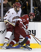 Carl Sneep (Boston College - Nisswa, Minnesota) and Tyler Magura (Harvard University - Fargo, ND) collide along the boards. The Boston College Eagles defeated the Harvard University Crimson 3-1 in the first round of the 2007 Beanpot Tournament on Monday, February 5, 2007, at the TD Banknorth Garden in Boston, Massachusetts.  The first Beanpot Tournament was played in December 1952 with the scheduling moved to the first two Mondays of February in its sixth year.  The tournament is played between Boston College, Boston University, Harvard University and Northeastern University with the first round matchups alternating each year.