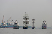 London, UK. 6 September 2014. Two tall ships at the Thames Barrier. Tall Ships sailing on the River Thames on the second day of the Royal Greenwich Tall Ships Festival 2014.