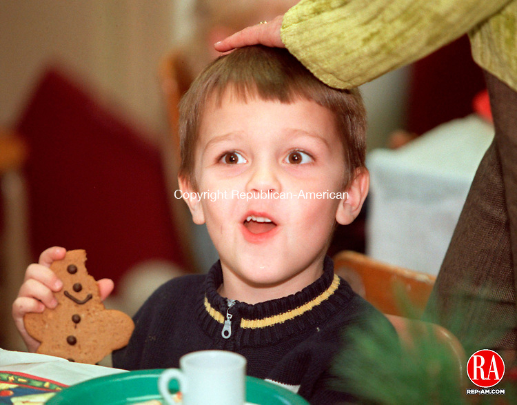 SOUTHBURY, CT 12/13/98 --1213JH12.tif--John Joseph Filippo, 4, of Southbury got a pat on the head as he enjoyed a cookie during the Teddy Bear Tea at the Old Town Hall Museum in South Britain Sunday. The event was sponsored by the Southbury Historical Society. JOHN HARVEY staff photo for Motz story.