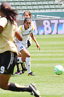 Marta #10 of the Los Angeles Sol looks to attack the defense of FC Gold Pride during their match at Home Depot Center on April 19, 2009 in Carson, California.