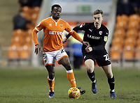 Blackpool's Marc Bola under pressure from Barnsley&rsquo;s Mike-Steven B&auml;hre<br /> <br /> Photographer Rich Linley/CameraSport<br /> <br /> The EFL Sky Bet League One - Blackpool v Barnsley - Saturday 22nd December 2018 - Bloomfield Road - Blackpool<br /> <br /> World Copyright &copy; 2018 CameraSport. All rights reserved. 43 Linden Ave. Countesthorpe. Leicester. England. LE8 5PG - Tel: +44 (0) 116 277 4147 - admin@camerasport.com - www.camerasport.com