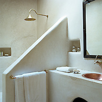 The walls of this ensuite bathroom are made from tadelakt, the ancient Moroccan plaster technique originally used in hammams