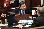 Nevada Senate Minority Leader Michael Roberson, R-Las Vegas, talks with Sen. David Parks, D-Las Vegas, on the Senate floor at the Legislative Building in Carson City, Nev., on Monday, March 11, 2013..Photo by Cathleen Allison