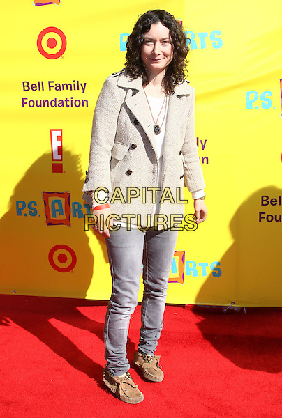 SARA GILBERT .P.S. Arts Express Yourself 2009 held At Moca, Santa Monica, California, USA, .15th November 2009..full length grey gray jacket jeans denim brown moccasins suede .CAP/ADM/KB.©Kevan Brooks/AdMedia/Capital Pictures.