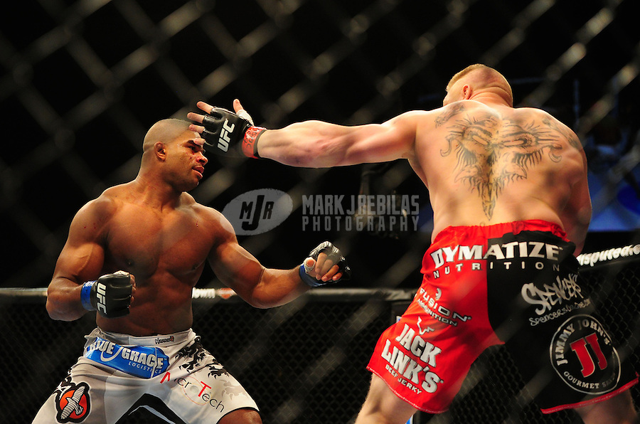 Dec 30, 2011; Las Vegas, NV, USA; UFC fighter Alistair Overeem (left) against Brock Lesnar during a heavyweight bout at UFC 141 at the MGM Grand Garden event center. Mandatory Credit: Mark J. Rebilas-