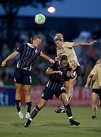 Becky Edwards (14) of FC Gold Pride goes up for a header against Abby Wambach (20) and Brittany Bock (5) of the Washington Freedom at the Maryland SoccerPlex in Boyds, Maryland. FC Gold Pride defeated the Washington Freedom, 4-1.