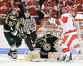 Nick Bruneteau (Vermont - 4) was able to knock down the puck past Rob Madore (Vermont - 29) and Chris Connolly (BU - 12). - The visiting University of Vermont Catamounts tied the Boston University Terriers 3-3 in the opening game of their weekend series at Agganis Arena in Boston, Massachusetts, on Friday, February 25, 2011.