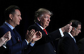 United States President Donald Trump flashes a thumbs up when Jordan's King Abdullah was introduced at the National Prayer Breakfast February 2, 2017 in Washington, DC. Every U.S. president since Dwight Eisenhower has addressed the annual event. Also pictured are (L-R) Mark Burnett and Sen. John Boozman (R-AR). <br /> Credit: Win McNamee / Pool via CNP