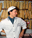 ITALY, Orvieto, Umbria, young butcher Emilio Gazzura in his family's meat market.