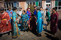 Mongolian newlyweds and relatives have a group photo taken before a traditional wedding ceremony in Damao Banner, Inner Mongolia, China, October 2014.