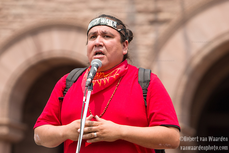Clayton Thomas-Muller directs the march participants before the Jobs, Justice and Climate march in Toronto. On July 5th more than 10,000 people gathered in Toronto, the traditional territories of the Missisauga peoples, for the March for Jobs, Justice and the Climate. The march told the story of a new economy that works for people and the planet. People marched for an economy that starts with justice, creates good work, clean jobs and healthy communities. The people recognize that we have solutions and we know who is responsible for causing the climate crisis. (Photo: Robert van Waarden)