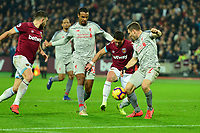 James Milner of Liverpool blocks a shot from Javier Hernandez of West Ham United during West Ham United vs Liverpool, Premier League Football at The London Stadium on 4th February 2019