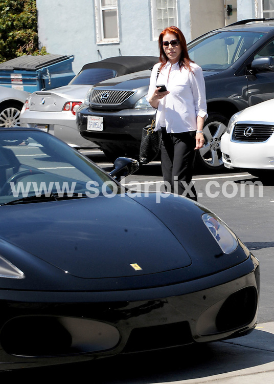 **ALL ROUND EXCLUSIVE PICTURES FROM SOLARPIX.COM**.**SYNDICATION RIGHTS FOR UK AND SPAIN ONLY**.Priscilla Presley shows off her new Ferrari and her horrible plastic surgery face in Hollywood. Los Angeles, California, USA. 3 August 2010..This pic: Priscilla Presley..JOB REF: 11830 STL        DATE: 03_08_2010.**MUST CREDIT SOLARPIX.COM OR DOUBLE FEE WILL BE CHARGED**.**MUST NOTIFY SOLARPIX OF ONLINE USAGE**.**CALL US ON: +34 952 811 768 or LOW RATE FROM UK 0844 617 7637**