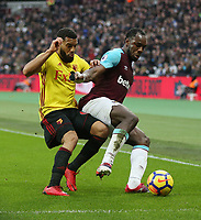 West Ham United's Michail Antonio and Watford's Adrian Mariappa<br /> <br /> Photographer Rob Newell/CameraSport<br /> <br /> The Premier League - West Ham United v Watford - Saturday 10th February 2018 - London Stadium - London<br /> <br /> World Copyright &copy; 2018 CameraSport. All rights reserved. 43 Linden Ave. Countesthorpe. Leicester. England. LE8 5PG - Tel: +44 (0) 116 277 4147 - admin@camerasport.com - www.camerasport.com
