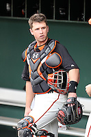 Buster Posey #28 of the San Francisco Giants prepares for the game against the Arizona Diamondbacks in the first spring training game of the season at Scottsdale Stadium on February 25, 2011  in Scottsdale, Arizona. .Photo by:  Bill Mitchell/Four Seam Images.