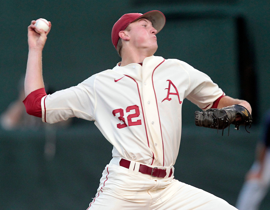 Arkansas pitcher Zach Jackson (32) throws the ball in the first inning during an NCAA college baseball regional tournament game against Virginia in Charlottesville, VA., Friday, June 1, 2014. (Photo/Andrew Shurtleff)