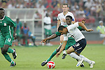 13 August 2008: Charlie Davies (USA) (9) is challenged from behind by a Nigeria defender.  The men's Olympic team of Nigeria defeated the men's Olympic soccer team of the United States 2-1 at Beijing Workers' Stadium in Beijing, China in a Group B round-robin match in the Men's Olympic Football competition.