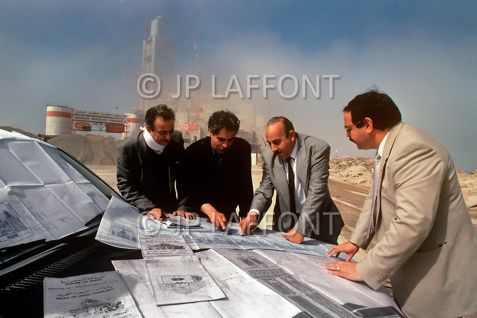 March 4, 1989, Casablanca, Morocco. Informal construction meeting of Bymaro supervisors on a car hood outside the Hassan II Mosque. Bymaro Corp.  was responsible for the construction. The mosque was completed in 1993.